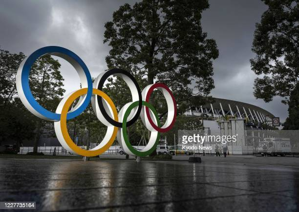 Photo shows a monument depicting the Olympic rings in front of the National Stadium in Tokyo, the main venue for the Tokyo Olympics and Paralympics,...