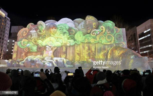 Photo shows a projection mapping show on a snow sculpture featuring the Ainu indigenous people of Japan's northernmost main island of Hokkaido on...