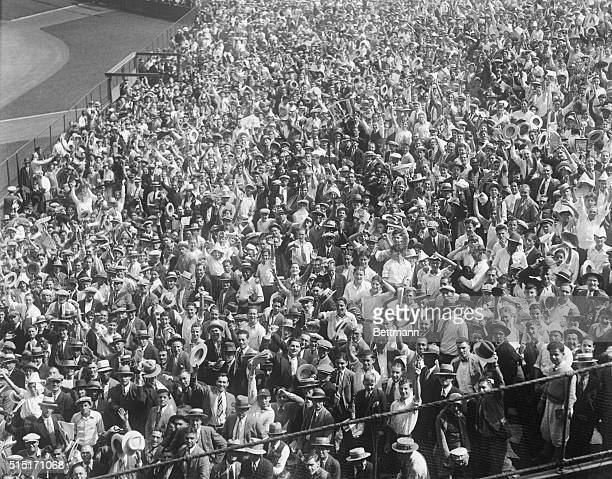 Photo shows a section of the tremendous throng of baseball fans as they appeared in right field bleachers at Yankee Stadium for the opening of the...