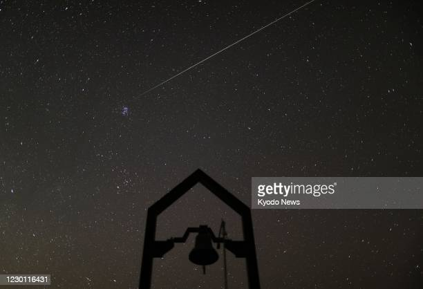 Photo shows a shooting star of the Geminid meteor shower observed from Nosegawamura in Nara Prefecture, western Japan, on Dec. 13, 2020. This year's...