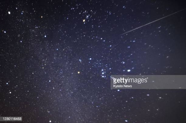 Photo shows a shooting star of the Geminid meteor shower observed from Futaba in Fukushima Prefecture, northeastern Japan, on Dec. 13, 2020. This...