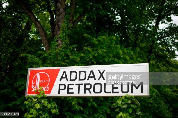 A photo shows a sign of Addax Petroleum outside its headquarters on May 7 2017 in Geneva Last March Swiss petroleum company Addax Petroleum was...