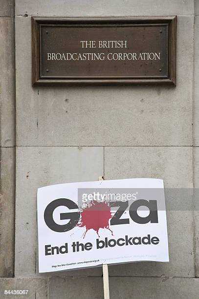 Photo shows a sign placed against the outside of the BBC offices in London on January 24 in protest against their decision not to broadcast a charity...