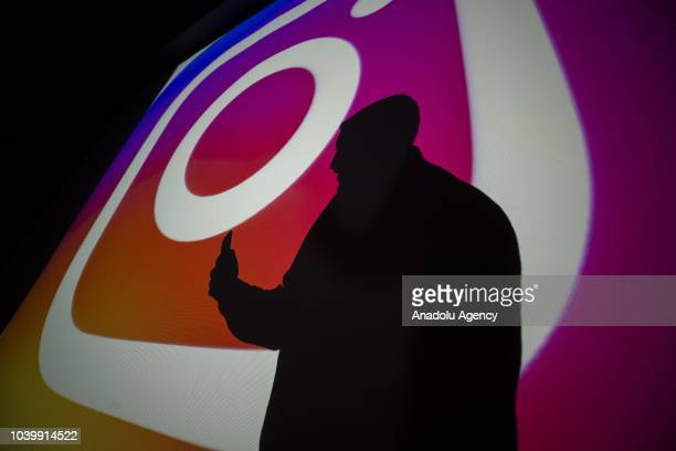 A photo shows a silhoutte of a man in front of the logo of 'Instagram' social media platform in Ankara Turkey on September 25 2018
