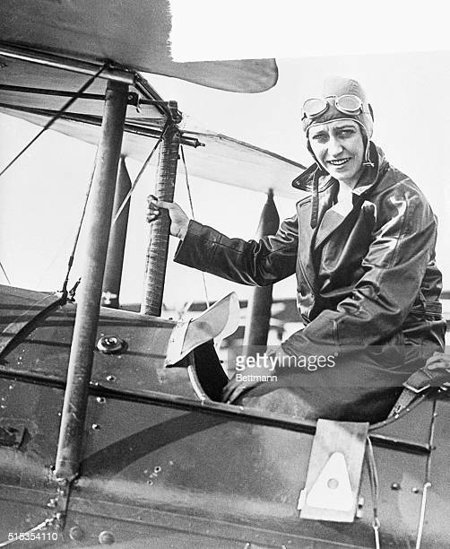 9/4/1930 Photo shows a smiling Amy Johnson in the cockpit of her airplane