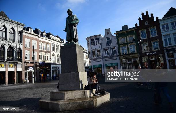 A photo shows a statue of Dutch painter Hieronymus Bosch in front of his workshop in Den Bosch on February 11 2016 To mark the 500th anniversary of...