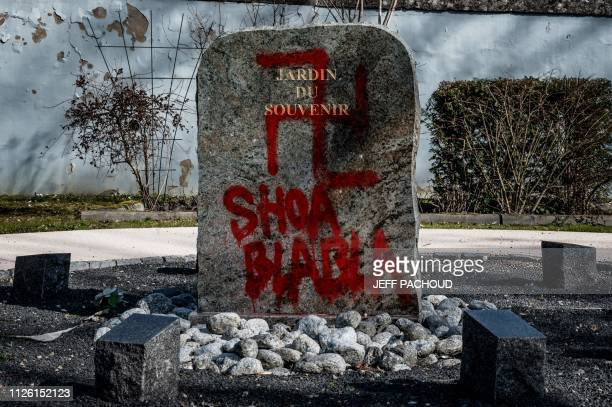 TOPSHOT A photo shows a swastika and the words Shoa blabla on the stele of the Jardin du Souvenir after antisemitic graffiti was discovered in the...