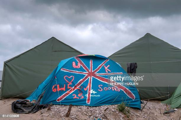 TOPSHOT A photo shows a tent painted with the British flag at the 'Jungle' migrant camp in Calais on October 12 2016 French authorities are preparing...