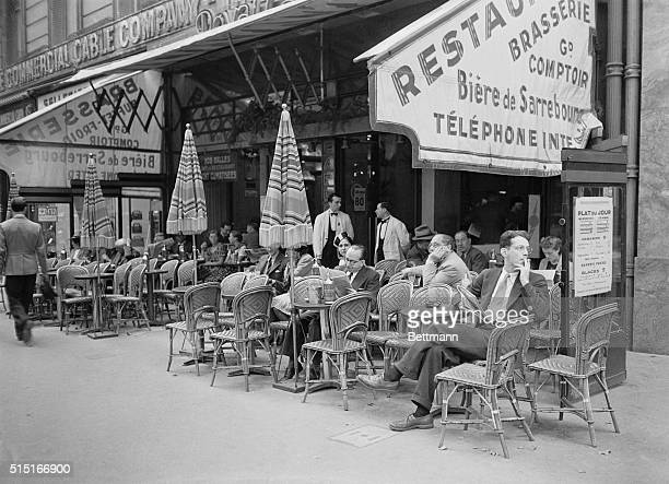 Photo shows a typical view of a Paris sidewalk cafe a few days ago, as all of the continent thought of a possible war. In this photo, as elsewhere,...