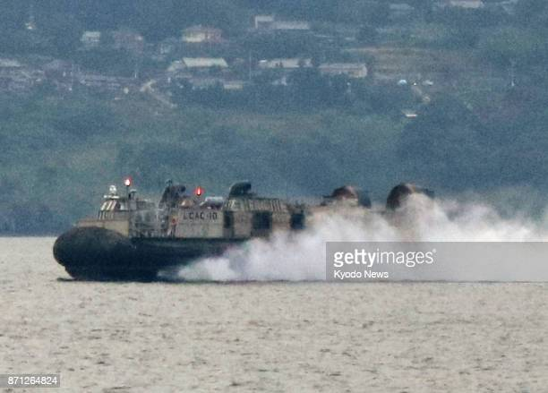 Photo shows a US military Landing Craft Air Cushion hovercraft during night training off Saikai in Nagasaki Prefecture southwestern Japan on Nov 7...