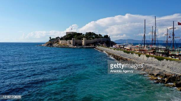 A photo shows a view of Guvercinada Castle on May 29 2020 at Kusadasi district in Aydin Turkey Guvercinada Castle added to the UNESCO World Heritage...