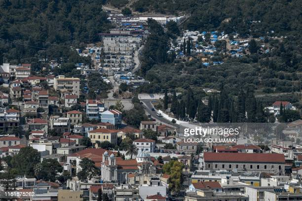 A photo shows a view of the city of Vathy on Samos island and the island's refugee hotspot above the city the Samos camp built for 650 housing now...