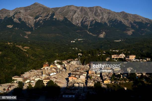A photo shows a view of the remains of Amatrice on August 23 2017 a year after a deadly earthquake left nearly 300 people dead and destroyed the...