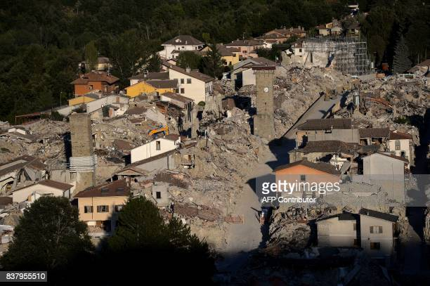TOPSHOT A photo shows a view of the remains of Amatrice on August 23 2017 a year after a deadly earthquake left nearly 300 people dead and destroyed...
