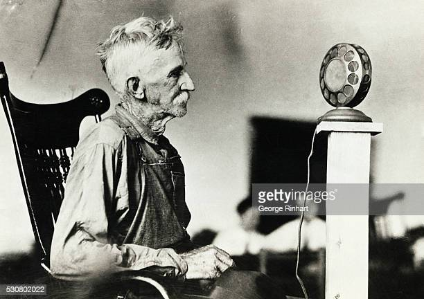 Photo shows a witness at the Scopes trail at Dayton Tennessee testifying before the microphone the first time it has been done in the history of radio