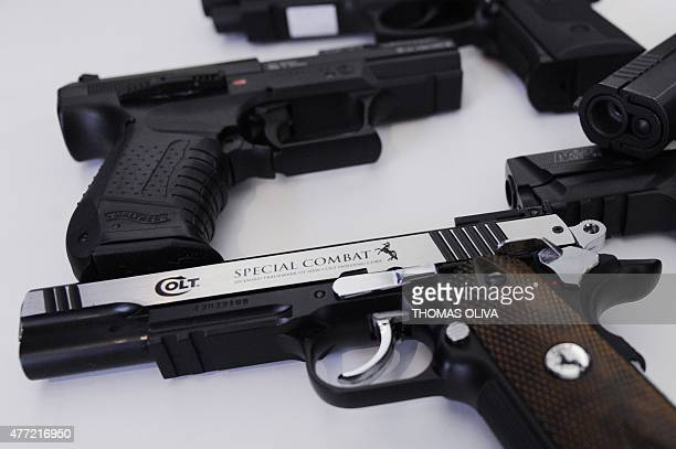 A photo shows airsoft pistols in a gun shop in Paris on June 15 2015 AFP PHOTO / THOMAS OLIVA
