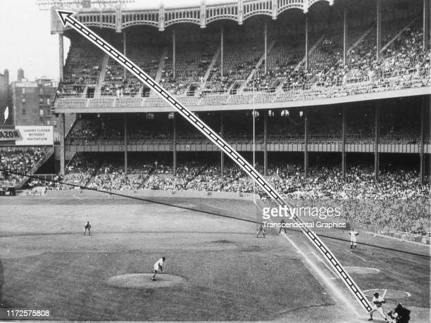 Photo shows American baseball player Mickey Mantle of the New York Yankees at bat during a game at Yankee Stadium and dotted lines that show the...
