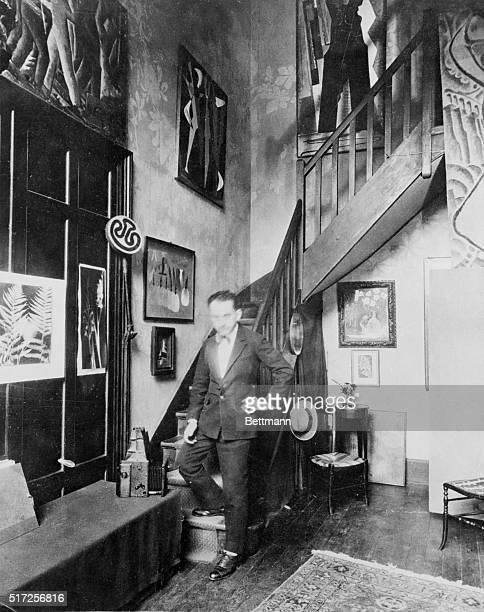 Photo shows American photographer Man Ray standing in his studio when he was at work in Paris in the 1920s.