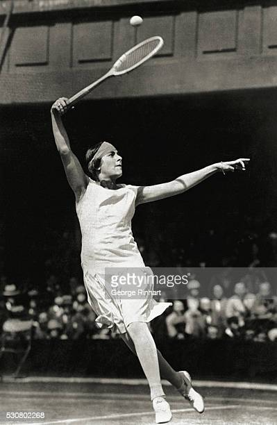 Photo shows an unusually good action picture of the marvelous grace of the Spanish tennis star Senorita de Alvarez The strenuous game of tennis...