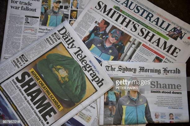 TOPSHOT Photo shows Australian cricket captain Steve Smith on the front pages of the major newspapers in Sydney on March 26 2018 Australia's...