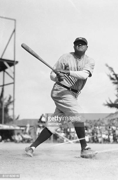Photo shows Babe Ruth batting.