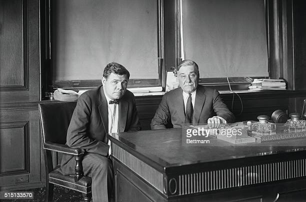 Photo shows Babe Ruth the deposed idol of fandom as he conferred with Col Ruppert owner of the New York Yankees in the latter's office as to the fine...