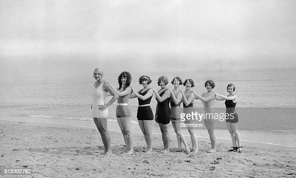 1/4/1926ORIGINAL CAPTION READS Photo shows bathing girls on the beach at Hollywood FL Here they are lined up hands on each others shoulders