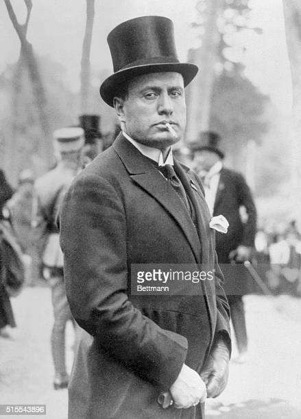 Photo shows Benito Mussolini acclaimed as the Theodore Roosevelt of Italy caught by the camera in a rather picturesque pose in Rome during the recent...