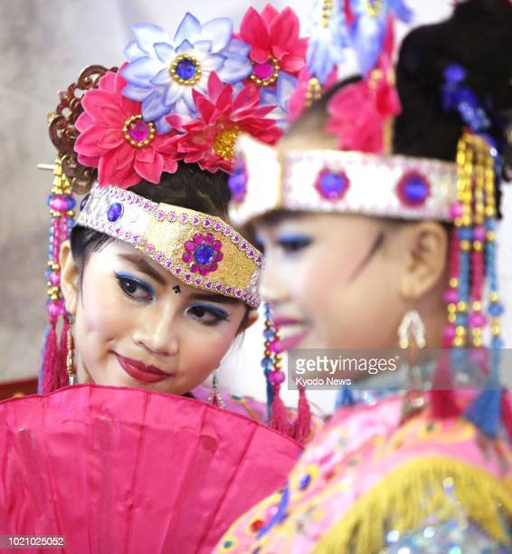 Photo shows Betawi women from an Indonesian ethnic group after their performance at the opening ceremony of the Asian Games main press center in...
