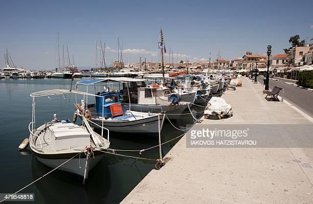 A photo shows boats on July 5 2015 in Aegina AFP PHOTO / IAKOVOS HATZISTAVROU