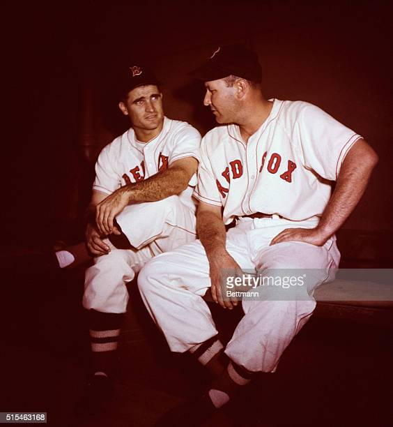 Photo shows Bobby Doerr and Rudy York of the Boston Red Sox seated on a bench and talking
