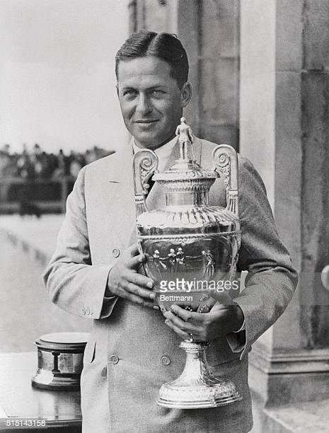 Photo shows Bobby Jones holding his victory cup emblematic of his winning the British Amateur Golf Championship at St. Andrews, England when he beat...