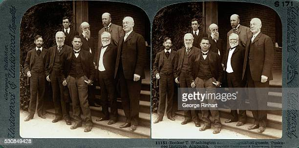 Photo shows Booker T Washington with distinguished guests at the Tuskegee Institute in Alabama Front left to right Charles W Eliot President of...