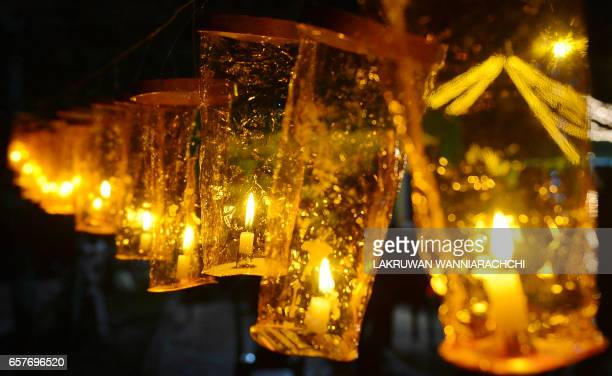 TOPSHOT A photo shows candles during the Earth Hour in Colombo on March 25 2017 Millions of people were expected to switch off their lights for Earth...