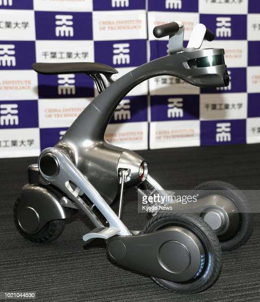 Photo shows 'CanguRo' an intelligent robot that can transform into a mini bike unveiled in Tokyo on July 4 2018 The robot developed by the Future...