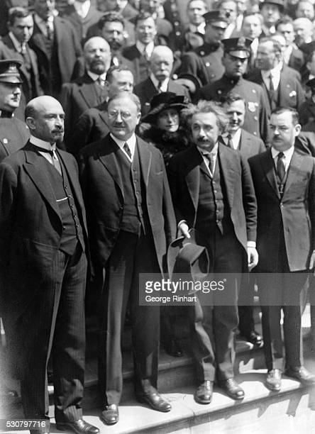 Photo shows Chaim Weizmann Mayor John F Hyland and Albert Einstein apparently standing on steps during a parade in New York