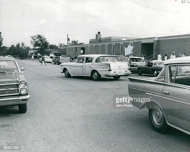 SEP 27 1969 OCT 1 1969 Photo Shows Congestion At School When Kindergarten Class Is Dismissed The automobile indicated by arrow causes a traffic jam...