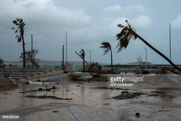 TOPSHOT A photo shows debris in a street in Marigot on the French Caribbean island of Saint Martin as preparations are made for the arrival of...
