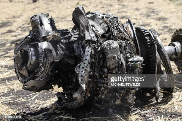 A photo shows debris of the crashed airplane of Ethiopia Airlines near Bishoftu a town some 60 kilometres southeast of Addis Ababa Ethiopia on March...