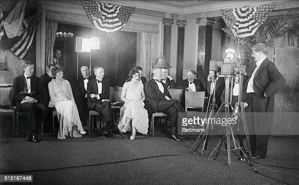 Photo shows Dr. James H. Kimball broadcasting over the radio as left to right Colonel Charles Lindbergh, Amelia Earhart, Clarence Chamberlin, Ruth...