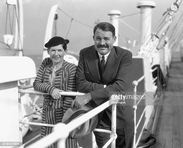 Photo shows Ernest Hemingway, the well-known writing gentleman, with his second wife Pauline. They were among the passengers on the S.S. Paris on its...