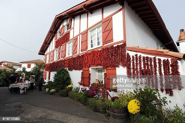A photo shows Espelette peppers on display on the wall of a house on October 30 2016 in Espelette southern France during the celebration of the...