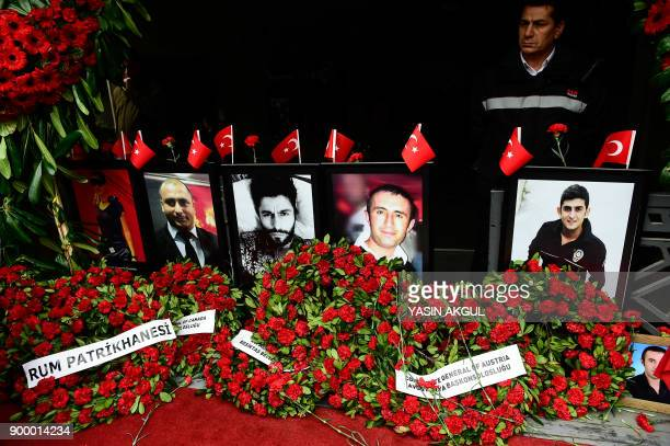 TOPSHOT A photo shows flowers left near portraits of victims in front of the Reina nightclub in Istanbul on December 31 a year after an attack on the...