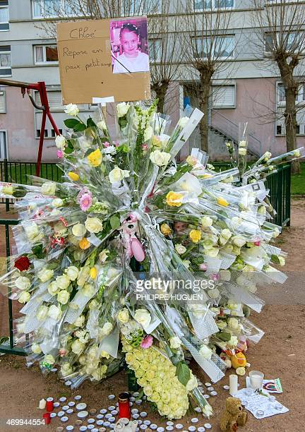 A photo shows flowers on a playground in homage to Chloe a nineyearold girl who was killed a day before on April 16 2015 in Calais northern France A...
