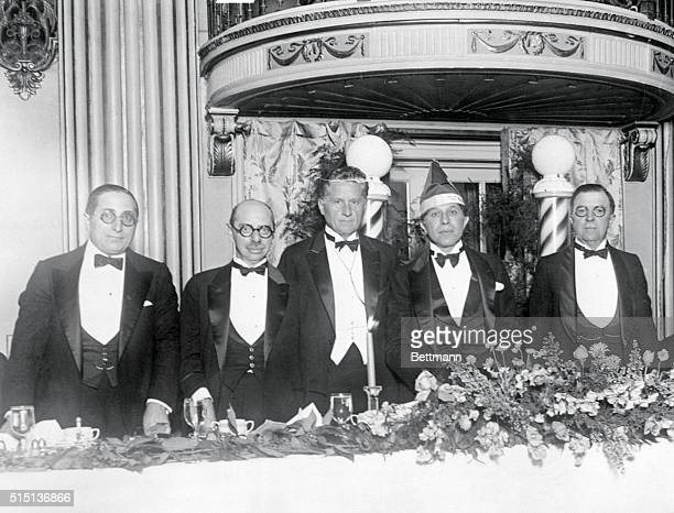 Photo shows four of film industry's leaders who were on hand to add their tribute to their friend Sid Grauman the Los Angeles Motion Picture Theatre...