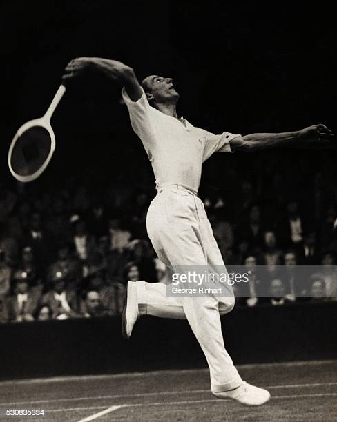 Photo shows Fred J Perry in play against B H Grant on Court No 1 at Wimbledon this afternoon