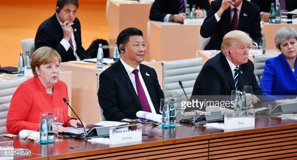 Photo shows German Chancellor Angela Merkel Chinese President Xi Jinping and US President Donald Trump at a Group of 20 summit meeting in Hamburg...
