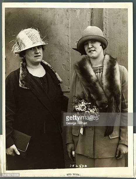 Photo shows Gertrude Ederle champion swimmer as she sailed today Her mother is pictured with her on board the SS Berenbaria
