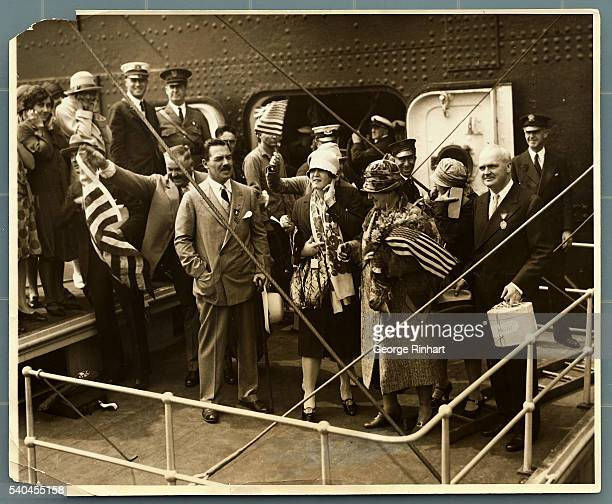 Photo shows Gertrude Ederle her parents and officials who welcomed her as she boarded the City Tug Macom which went down the bay to meet Miss Ederle...
