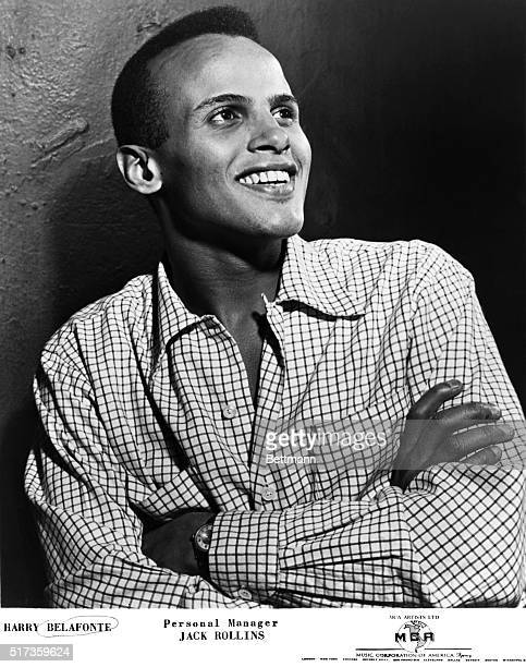 Photo shows Harry Belafonte in a publicity handout, posed with his arms folded and his smile gleaming. Ca. 1940s-1950s.